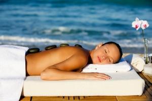 woman getting hot stone spa massage
