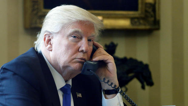 Trump speaks by phone with Merkel in the Oval Office at the White House in Washington