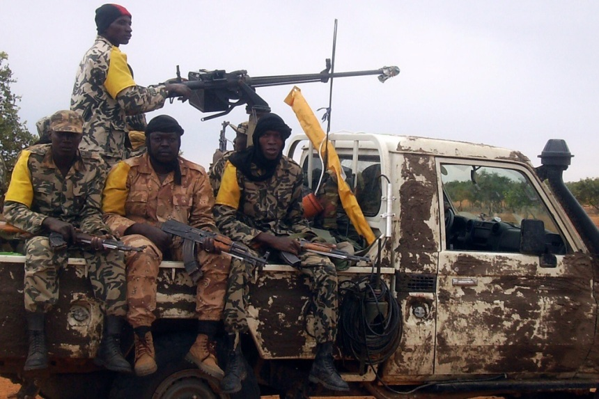 Malian troops patrol on a pick-up car on